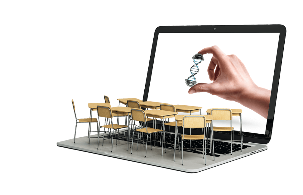 classroom tables on the keyboard of a laptop displaying a hand holding a dna strand